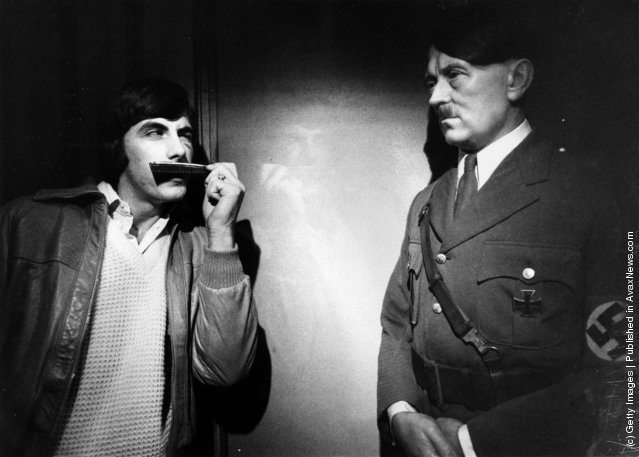 1980: A visitor to Madame Tussaud's tries the effect of a pocket comb to mimic Adolf Hitler's moustache