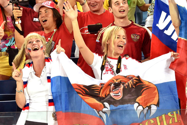 Russia fans cheer their team during the 2014 FIFA World Cup Group H football match between Russia and South Korea in the Pantanal Arena in Cuiaba on June 17, 2014. (Photo by Kirill Kudryavtsev/AFP Photo)