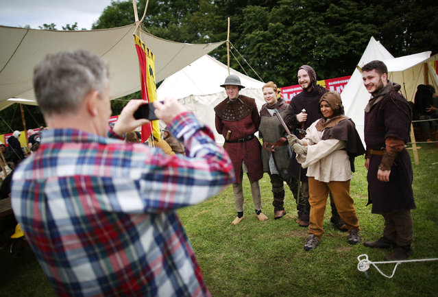 Re-enactors pose for photographs at the Bannockburn Live event on June 28, 2014 in Stirling, Scotland. The 700th anniversary of the historic battle that saw the outnumbered Scots conquer the English led by Edward II in the First War of Scottish Independence. (Photo by Peter Macdiarmid/Getty Images)