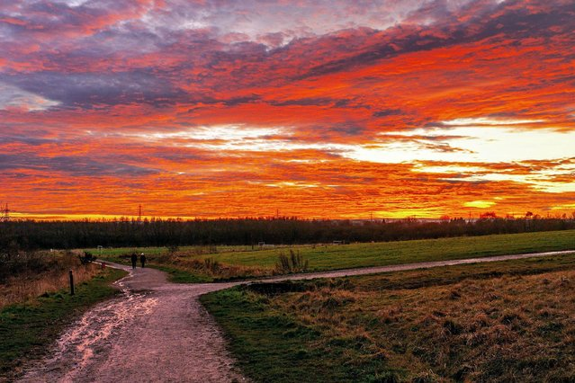 Rabbit Ings Country Park in Royston, near Barnsley, England was cast in an orange glow from clouds as the sun set yesterday,  December 29, 2019. (Photo by Paul Biggins/Alamy Live News)