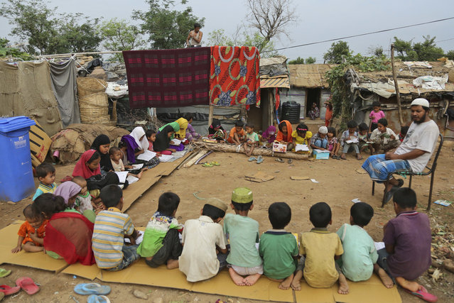 Rohingya refugee children attend a Madrassa, or Islamic religious school in a temporary shelter on the outskirts of Jammu, India, Tuesday, June 20, 2017. Facing persecution in Myanmar, thousands of members of Myanmar's minority Rohingya community have crossed over to India over the past years. Tuesday marks World Refugee Day. (Photo by Channi Anand/AP Photo)