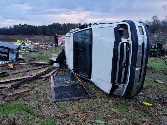 This handout image obtained courtesy of Bossier Parish, Louisiana, Sheriff's Office shows the aftermath of a powerfull storm on January 11, 2020. Severe storms sweeping across the southern US have killed at least 11 people as tornadoes and high winds upturned cars, destroyed homes and left thousands without power. The bodies of a couple were found in Louisiana on Saturday near their destroyed mobile home after it was hit by storms the night before, said Bill Davis of the county sheriff's office. (Photo by Handout/Bossier Parish Florida Sheriff's Office/AFP Photo)