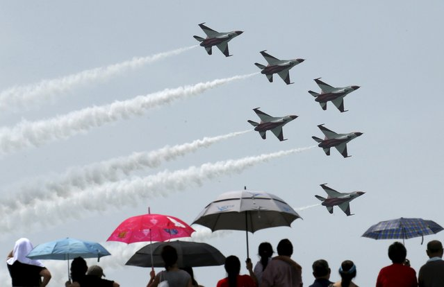 The Republic of Singapore Air Force Black Knights aerobatics team performs a manoeuvre during an aerial display ahead of Singapore's Golden Jubilee celebrations along the southern coast of Singapore August 8, 2015. Singapore marks 50 years of independence on Sunday. (Photo by Edgar Su/Reuters)