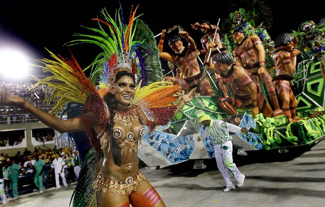 Performers from the Mocidade Independente de Padre Miguel samba school join in the celebrations at the Sambadrome in Rio de Janeiro