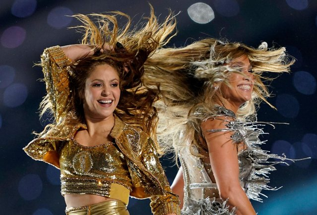 Shakira and Jennifer Lopez perform onstage during the Pepsi Super Bowl LIV Halftime Show at Hard Rock Stadium on February 02, 2020 in Miami, Florida. (Photo by Mike Blake/Reuters)