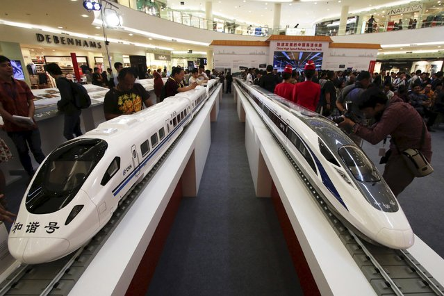 Models of high speed trains are seen during the China High Speed Railway on Fast Track exhibition in Jakarta, Indonesia, August 13, 2015 in this photo taken by Antara Foto. (Photo by Rivan Awal Lingga/Reuters/Antara Foto)