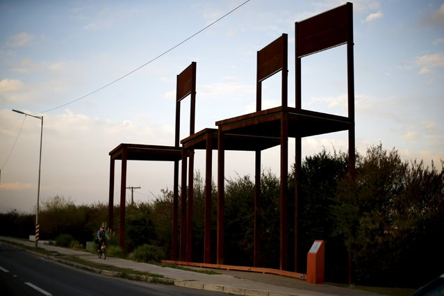 A memorial with giant classroom chairs is seen at the place where three teachers were killed by formers policemen during Augusto Pinochet's dictatorship in Santiago, Chile August 13, 2015. The Chilean Supreme Court in July granted parole to a former police agent who was convicted with other officers for the murder of three opponents teachers during the dictatorship of Pinochet, according to local media. (Photo by Ivan Alvarado/Reuters)