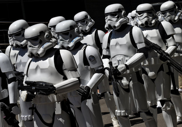 People wearing Star Wars stormtrooper costumes are seen during the parade in Metropoli (Media Culture and Entertainment Festival) in Gijon, northern Spain, July 3, 2016. (Photo by Eloy Alonso/Reuters)