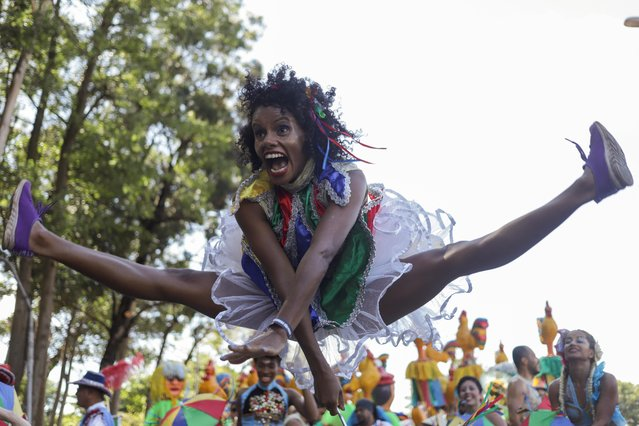 "A reveller performs while attending the block party ""Galo da Madrugada"" during carnival festivities in Sao Paulo, Brazil on February 25, 2020. (Photo by Rahel Patrasso/Reuters)"