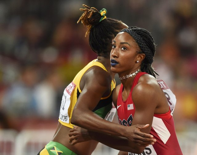 Brianna Rollins (R) embraces Shermaine Williams of Jamaica after their women's 100 metres hurdles semi-final during the 15th IAAF World Championships at the National Stadium in Beijing, China, August 28, 2015. (Photo by Dylan Martinez/Reuters)