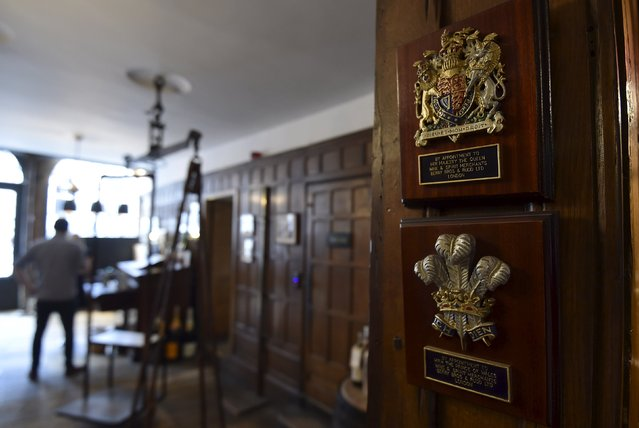Royal warrant plaques are seen inside Berry Bros and Rudd wine merchants in central London, Britain, August 21, 2015. Berry Bros. & Rudd, which started as grocers over 300 years ago in St. James's, central London, has two royal warrants. (Photo by Toby Melville/Reuters)