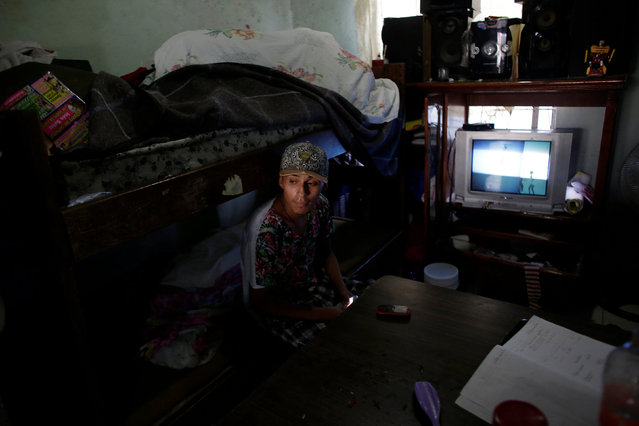 Daniel, who attends the meetings of Raza Nueva in Christ, a project of the archdiocese of Monterrey, sits on his bed in Escobedo, on the outskirts of Monterrey, Mexico, June 15, 2016. (Photo by Daniel Becerril/Reuters)