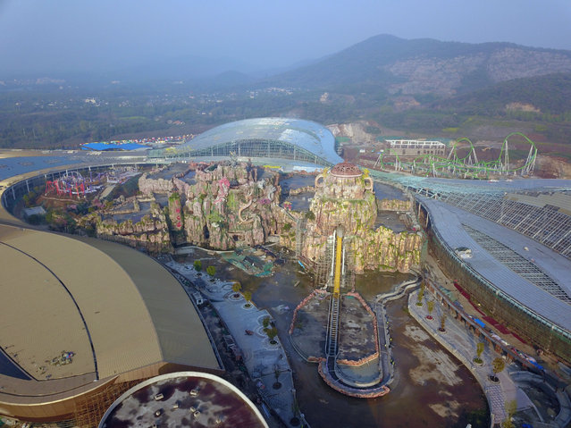 An aerial view of the Dragon Valley, the to-be largest Asia's indoor theme park, under construction, Nanjing city, east China's Jiangsu province on April 12, 2020. (Photo by Rex Features/Shutterstock)