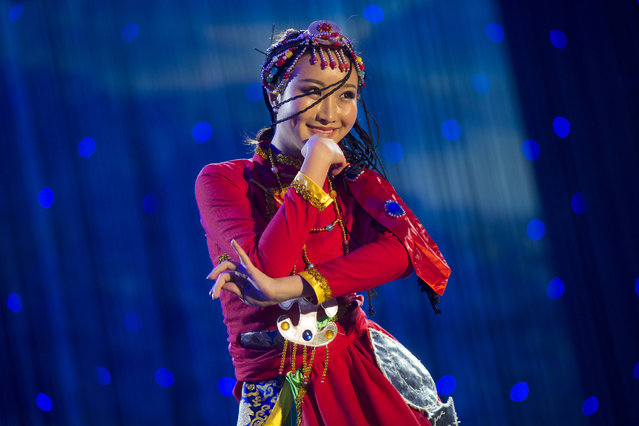 "Sitong Chen performs a traditional dance during the talent portion of the competition. The pageant promotes the preservation of Chinese culture while preparing the contestants for careers in an international environment. ""With globalization, the mesh of cultures is increasing"", said Xiren Wang. The pageant contestants say they seek to be the bridge between the rapidly growing Asian community in the U.S. and China. (Photo and caption by John Brecher/Sahra Vang Nguyen/NBC News)"
