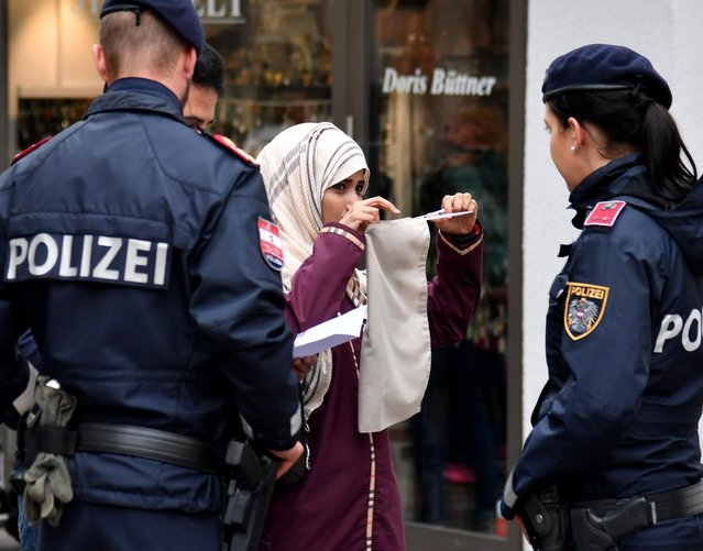 """A police patrol in Zell am See, Austria on Sunday, October 1, 2017. Items which cover the face, including the full Islamic veil, masks and scarves, have been outlawed in public places. Anyone flouting the law faces a fine of 150 euros. People are only allowed to wear them for special events or celebrations. Announcing the ban, officials in Vienna claimed it would encourage """"acceptance and respect of Austrian values"""". (Photo by Barbara Gindl/AFP Photo/APA)"""