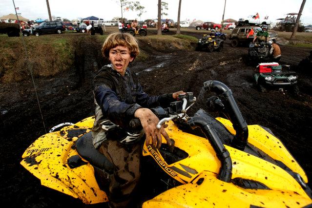 15-year-old Troy Carmen of Merritt Island sits on his ATV. (Photo by Gary Coronado/The Palm Beach Post)