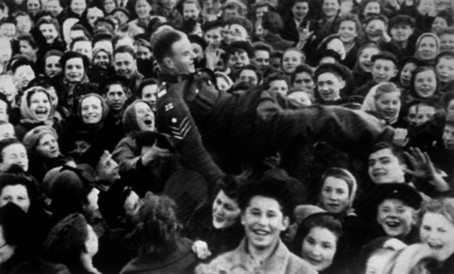 A British sergeant is lifted up as Moscow women celebrate VE Day, 8th May 1945.  (Photo by Keystone/Getty Images)