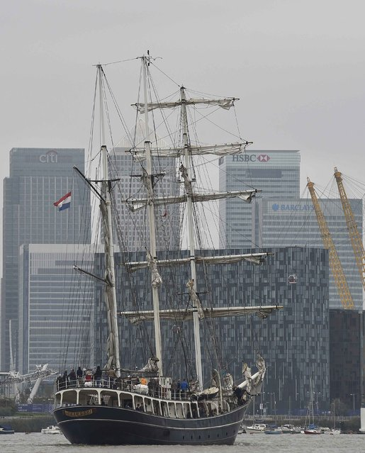 The tall ship Thalassa sails up the River Thames with the Canary Wharf business district seen in the background in London September 7, 2014. Over 50 tall ships from around the world will participate in the Royal Greenwich Tall Ships Regatta 2014 until Tuesday. (Photo by Toby Melville/Reuters)