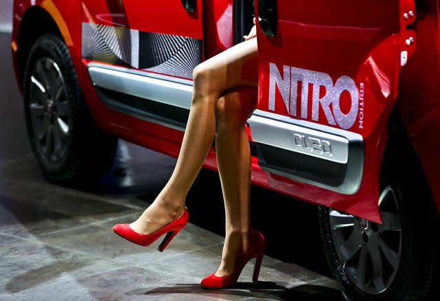 A model sits inside a Fiat Qubo Nitro automobile on the second day of the Paris Motor Show in France, on September 28, 2012. (Photo by Jason Alden/Bloomberg)