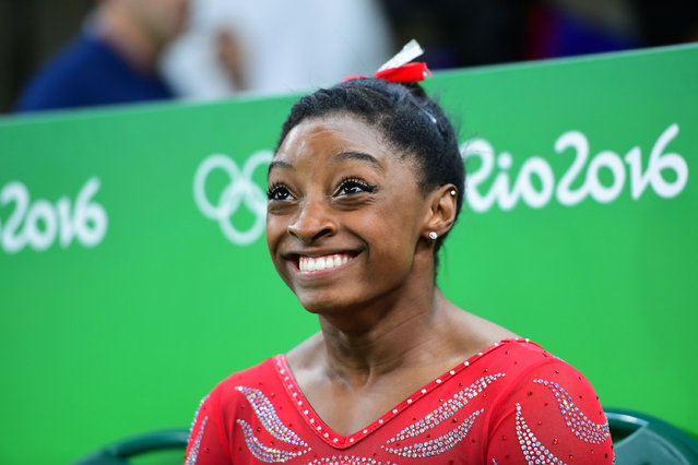 US gymnast Simone Biles smiles during a practice session of the women's Artistic gymnastics at the Olympic Arena on August 4, 2016 ahead of the Rio 2016 Olympic Games in Rio de Janeiro. (Photo by Emmanuel Dunand/AFP Photo)