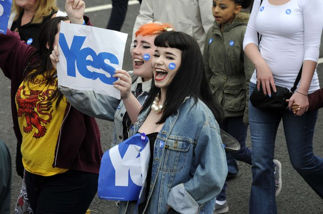 """Pro-independence """"Yes"""" campaigners stage a march towards the BBC Scotland Headquarters in Glasgow on September 14, 2014  to protest against alleged biased by the BBC in its coverage of the Scottish referendum.  Campaigners for and against Scottish independence scrambled for votes ahead of a historic referendum, as a religious leader prayed for harmony after polls showed Scots were almost evenly split. (Photo by Andy Buchanan/AFP Photo)"""