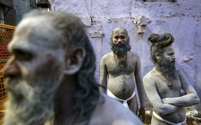 "Naga Sadhus, or Hindu holy men, wait during a procession before taking a dip in a holy pond during the second ""Shahi Snan"" (grand bath) at ""Kumbh Mela"", or Pitcher Festival, in Trimbakeshwar, India, September 13, 2015. (Photo by Danish Siddiqui/Reuters)"