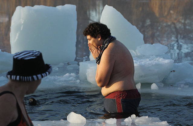 """Ice swimming enthusiasts take to the frigid waters of Orankesee lake during the 27th annual """"Winter Swimming in Berlin"""" on January 8, 2011 in Berlin, Germany. (Photo by Sean Gallup)"""
