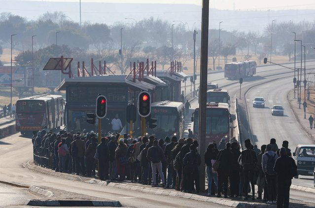 Buses are seen as stranded commuters wait for transportation at a bus terminal during a protest by taxi operators over the government's financial relief for the taxi industry, amid the coronavirus disease (COVID-19) lockdown, in Soweto, South Africa, June 22, 2020. (Photo by Siphiwe Sibeko/Reuters)