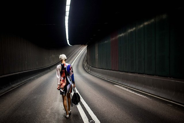 A model walks through an empty road tunnel for a photo shoot on October 8, 2014 in Hong Kong, Hong Kong. The tunnel was sealed off when pro-democracy protesters barricaded the entrance. With many protesters returning to work and school, supporter numbers have dwindled leaving a small number defying the governments request to leave the area. Student leaders and government officials have agreed to hold talks to end the two week protests. (Photo by Chris McGrath/Getty Images)