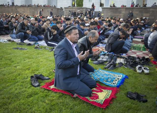 Muslims pray during Kurban-Ait, also known as Eid al-Adha in Arabic, in front of Central Mosque in Almaty, Kazakhstan, September 24, 2015. (Photo by Shamil Zhumatov/Reuters)