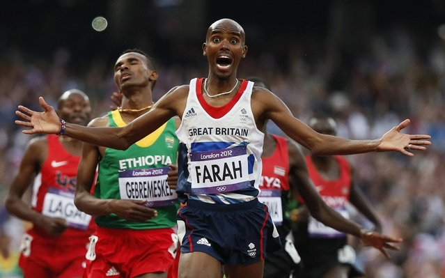 Britain's Mohamed Farah celebrates as he crosses the finish line to win the men's 5000-meter final during the athletics in the Olympic Stadium at the 2012 Summer Olympics, London, Saturday, August 11, 2012. (Photo by Anja Niedringhaus/AP Photo)