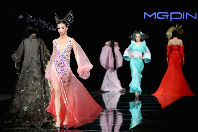 Models showcase designs on the runway at MGPIN 2015 Mao Geping Makeup Trends Launch show during Mercedes-Benz China Fashion Week Spring/Summer 2015 at Beijing Hotel on October 27, 2014 in Beijing, China. (Photo by Feng Li/Getty Images)