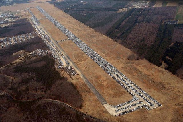 Tens of thousands of vehicles damaged by super storm Sandy are being temporarily stored on runways and taxiways at Calverton Executive Airpark in Calverton, New York, on January 9, 2013. (Photo by Stan  Honda/AFP Photo)