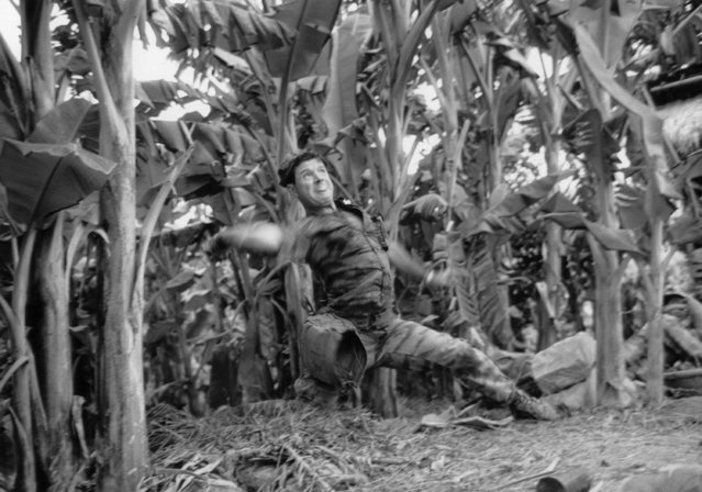 An American green beret hobs a grenade at a nearby north Vietnamese position near the Thuong Duc special forces camp, Vietnam, October 1, 1968. The embattled camp is southwest of Da Nang. (Photo by Peter Dejong/AP Photo/Phuoc)