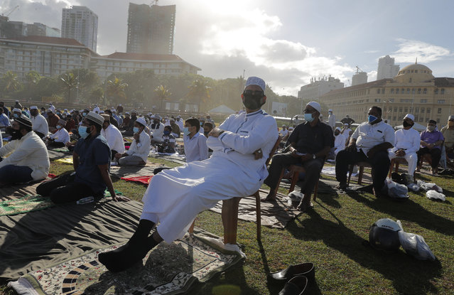 Sri Lankan Muslims attend a prayer session to mark Eid al-Adha, or Feast of Sacrifice, in Colombo, Sri Lanka, Saturday, August 1, 2020. The feast is marked by sacrificing animals to commemorate the prophet Ibrahim's faith in being willing to sacrifice his son. (Photo by Eranga Jayawardena/AP Photo)