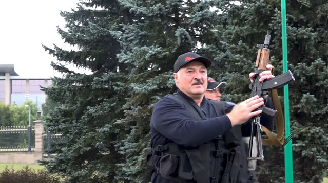 This image made from video provided by the State TV and Radio Company of Belarus, shows Belarus President Alexander Lukashenko armed with a Kalashnikov-type rifle near the Palace of Independence in Minsk, Belarus, Sunday, August 23, 2020. Lukashenko has made a dramatic show of defiance against the massive protests demanding his resignation, toting a rifle and wearing a bulletproof vest as he strode off a helicopter that landed at his residence while demonstrators massed nearby. (Photo by State TV and Radio Company of Belarus via AP Photo)