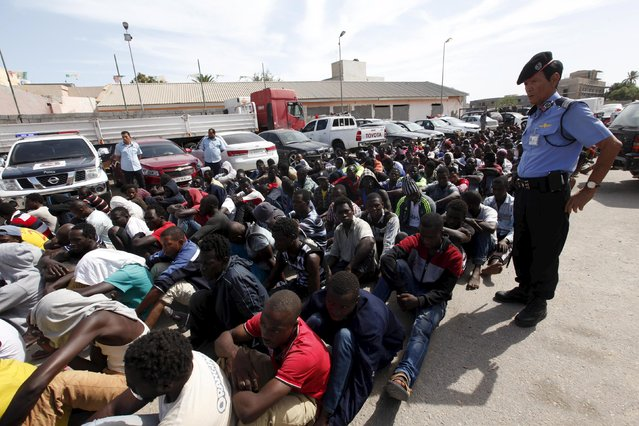 Illegal migrants sit at a temporary detention centre after they were detained by Libyan authorities in Tripoli, Libya October 8, 2015. (Photo by Ismail Zitouny/Reuters)