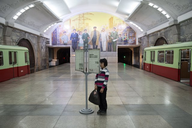 A young woman reads newspapers displayed inside a subway station visited by foreign reporters during a government organised tour in Pyongyang, North Korea October 9, 2015. (Photo by Damir Sagolj/Reuters)