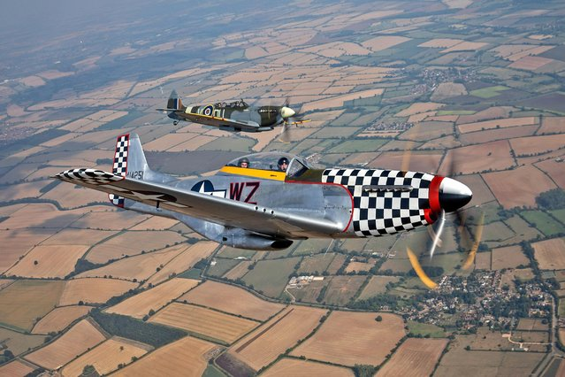 A British Spitfire and an American P-51 Mustang from Ultimate Warbird Flights take to the Northamptonshire on August 14, 2020 skies to mark the 75th anniversary of VJ Day. (Photo by Richard Pohle/The Times)