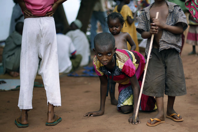 In this April 14, 2014 file photo, Hamamatou Harouna, 10, who lost the use of her legs to polio, crawls to the restroom on the grounds of the Catholic Church where she and hundreds of others found refuge after fleeing violence in her village, in Carnot, Central African Republic. Health authorities on Tuesday, August 25, 2020 are expected to declare the African continent free of the wild poliovirus after decades of effort, though cases of vaccine-derived polio are still sparking outbreaks of the paralyzing disease in more than a dozen countries. (Photo by Jerome Delay/AP Photo/File)