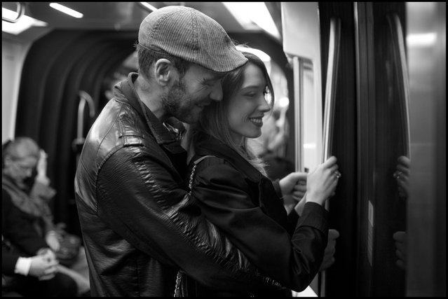 Paris grace. Gina and Jose ride home together at the end of a day on the Paris metro. (Photo and comment by Peter Turnley)