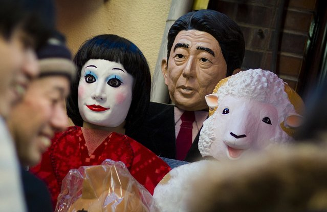 A mask of Japanese Prime Minister Shinzo Abe for sale at a market in Tokyo, November 27, 2014. Japanese voters head to the polls on Dec. 14 for a snap election called Abe that he says is a referendum on his economic policies and decision to put off an unpopular tax hike. (Photo by Thomas Peter/Reuters)