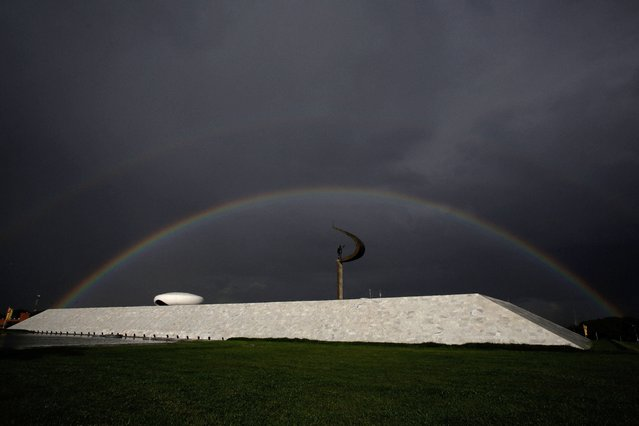Rainbow is seen over the JK Memorial in Brasilia, Brazil, Monday, November 17, 2014. The JK Memorial was designed by architect Oscar Niemeyer, inaugurated on September 12, 1981 and is dedicated to former Brazilian President Juscelino Kubitschek, founder of Brasilia. (Photo by Eraldo Peres/AP Photo)