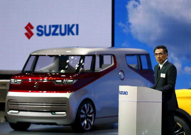 Suzuki Motor's President Toshihiro Suzuki presents the Air Triser concept car at the 44th Tokyo Motor Show in Tokyo, Japan, October 28, 2015. (Photo by Thomas Peter/Reuters)