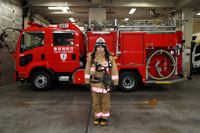 Ran Namise, 24, a firefighter belonging to the command squad, posing in front of a fire engine at Kojimachi Fire Station in Tokyo, Japan on February 23, 2018. (Photo by Kazuhiro Nogi/AFP Photo)