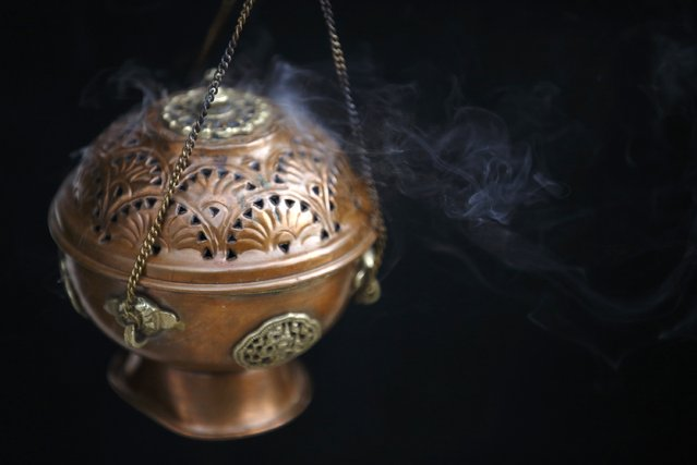Smoke rise from a traditional incense box used while offering prayers during a function organised by the Tibetan Refugee Community in Nepal, commemorating the 25th Anniversary of the Nobel Peace Prize conferment to exiled Tibetan spiritual leader Dalai Lama and the 66th International Human Rights Day in Kathmandu December 10, 2014. (Photo by Navesh Chitrakar/Reuters)