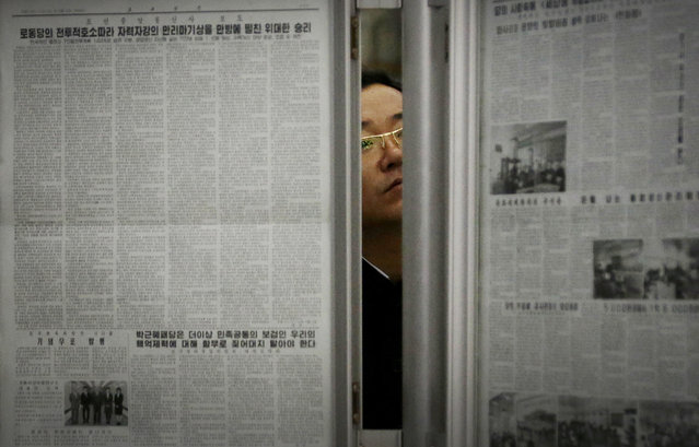 In this May 7, 2016, file photo, a North Korean man reads the local newspapers displayed in a subway station as seen during a press tour in Pyongyang, North Korea. (Photo by Wong Maye-E/AP Photo)