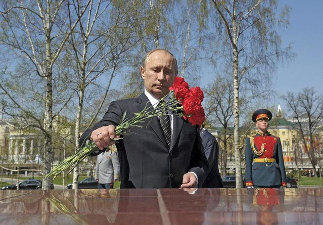Russia President Vladimir Putin takes part in a wreath laying ceremony at the tomb of the unknown soldier on the eve of Victory Day in Moscow May 8, 2013. (Photo by Alexei Druzhinin/Reuters/RIA Novosti)