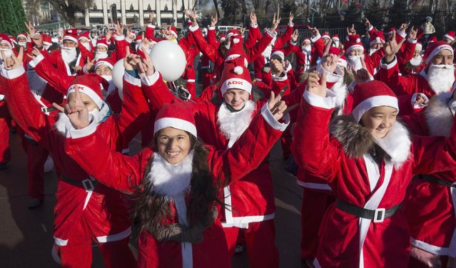 Revelers dressed as Father Frost, the equivalent of Santa Claus, dance during a parade in Almaty December 28, 2014. (Photo by Shamil Zhumatov/Reuters)