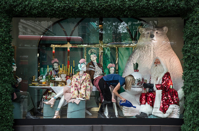 "A shopfitter hoovers the floor of a Selfridge's Christmas window display at the flagship store on Oxford Street on October 20, 2016 in London, England. The 2016 Selfridges Christmas window displays are were unveiled for the first time today and are often the first to do so in London. The 2016 theme is titled ""Shine on"" and features Father Christmas in many of the windows. (Photo by Chris J. Ratcliffe/Getty Images)"